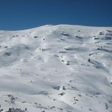 Gipfelhang - an den Spuren kann man die Schnee Qualität beurteilen