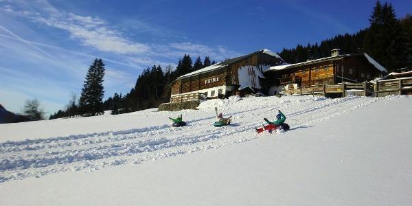 Kids snowtubing at Rösteralm in Vorberg