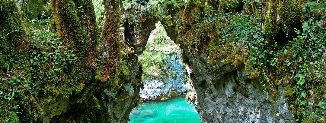 The rock gate towering above the shimmering green Mrtvica river