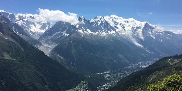 In the distance you will see Chamonix, with the snowy white peaks towering above.