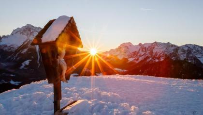 das Kreuz beim Sonnenuntergang