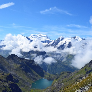 View on the Lac Louvie mountain lake and the Grand Combin peaks