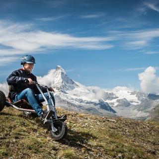 On three wheels down the mountain