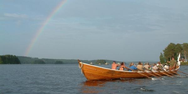 Pilgrims rowing across the lake Bergviken to the church of Segersta