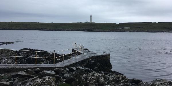Port Wemyss pier and Rhinns Lighthouse, Isle of Orsay