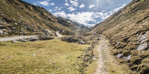 Ascent to Preuneggsattel mountain saddle via the historic Roman trail