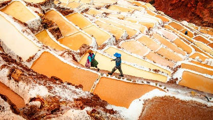 Hike from the fascinating agricultural rings of Moray to the ancestral salt mines of Maras