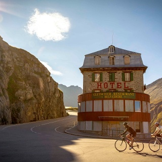Cyclists in front of Hotel Belvedere, Furka Pass