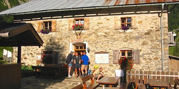 Culinaric stop at the Rifugio dei Becchi mountain hut in the Val Sopranes valley.