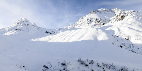 Over wide withe slopes up to the Punta Elle peak in Val di Fleres valley.