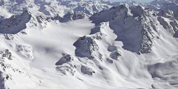 The white landscape of the Sesvenna Group in winter time.