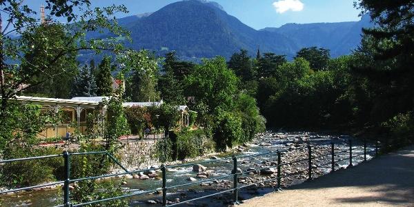 Il Passirio river and the winter trail in Merano. In the back the Picco d' Ivigna mountain.