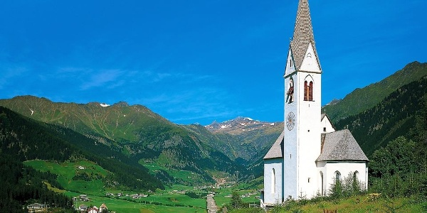 The Church of St. Magdalena in Ridnaun is situated on a hill with a magnificent view