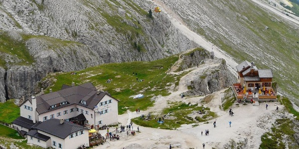 Hut Vajolet is surrounded by the spendid Dolomites under the Vajolet towers.