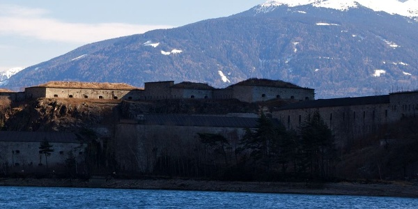 View over the reservoir to the lower part of the massive fortress Franzensfeste - Fortezza.