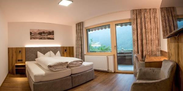 sonnenhang-montafon-komfort-doppelzimmer-schlafzim