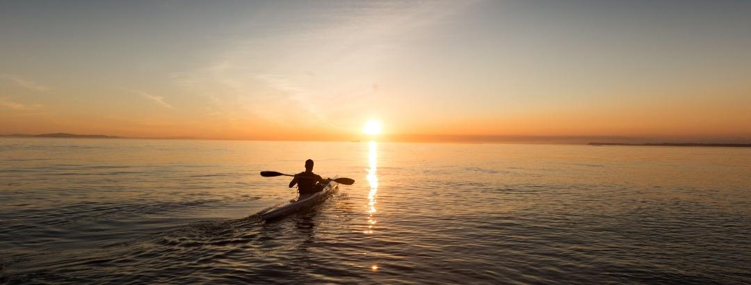 Kajaktour in den Sonnenuntergang