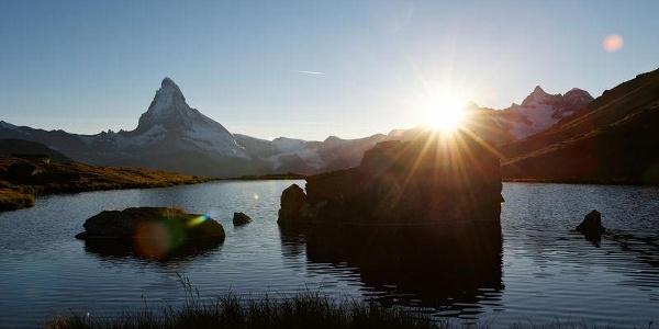 Romantic: sunset at the Stellisee lake above Zermatt.